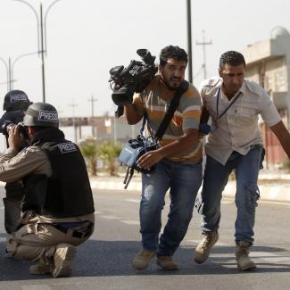 Journalists are seen as the security forces clash with Daesh terrorists in Domiz district of Kirkuk, Iraq on October 22, 2016.