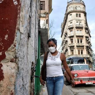 A woman wearing a face mask walks in Havana on September 14, 2020.