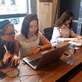 Young Central Asian analysts and journalists working on their articles at Georgian Sova.news agency. (Photo: IWPR/CABAR)