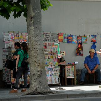 A street vendor sells newspapers and magazines in Tbilisi, Georgia. (Photo: Mark Runnacles/Getty Images)