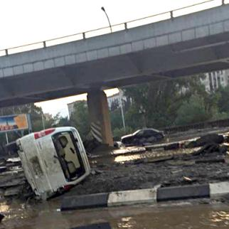 An overturned car among the debris left by the flooding. (Photo: Tbilisi City Hall)