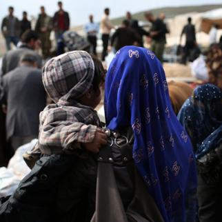 A group of refugees returning to northeast Syria. (Photo: John Moore/Getty Images)