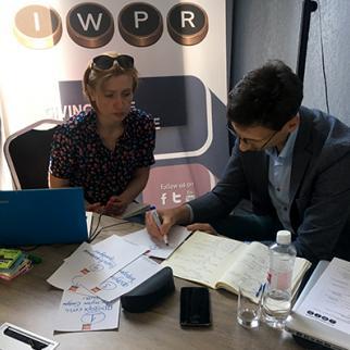 Trainers Iryna Negreyeva and Vitaliy Moroz developing ideas for group work. (Photo: IWPR)