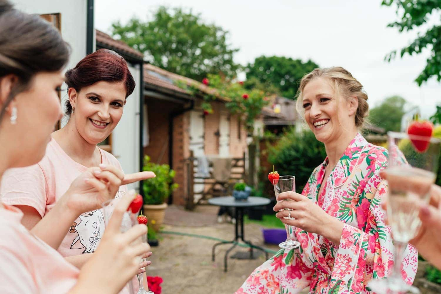 bridesmaids drinking champagne outside