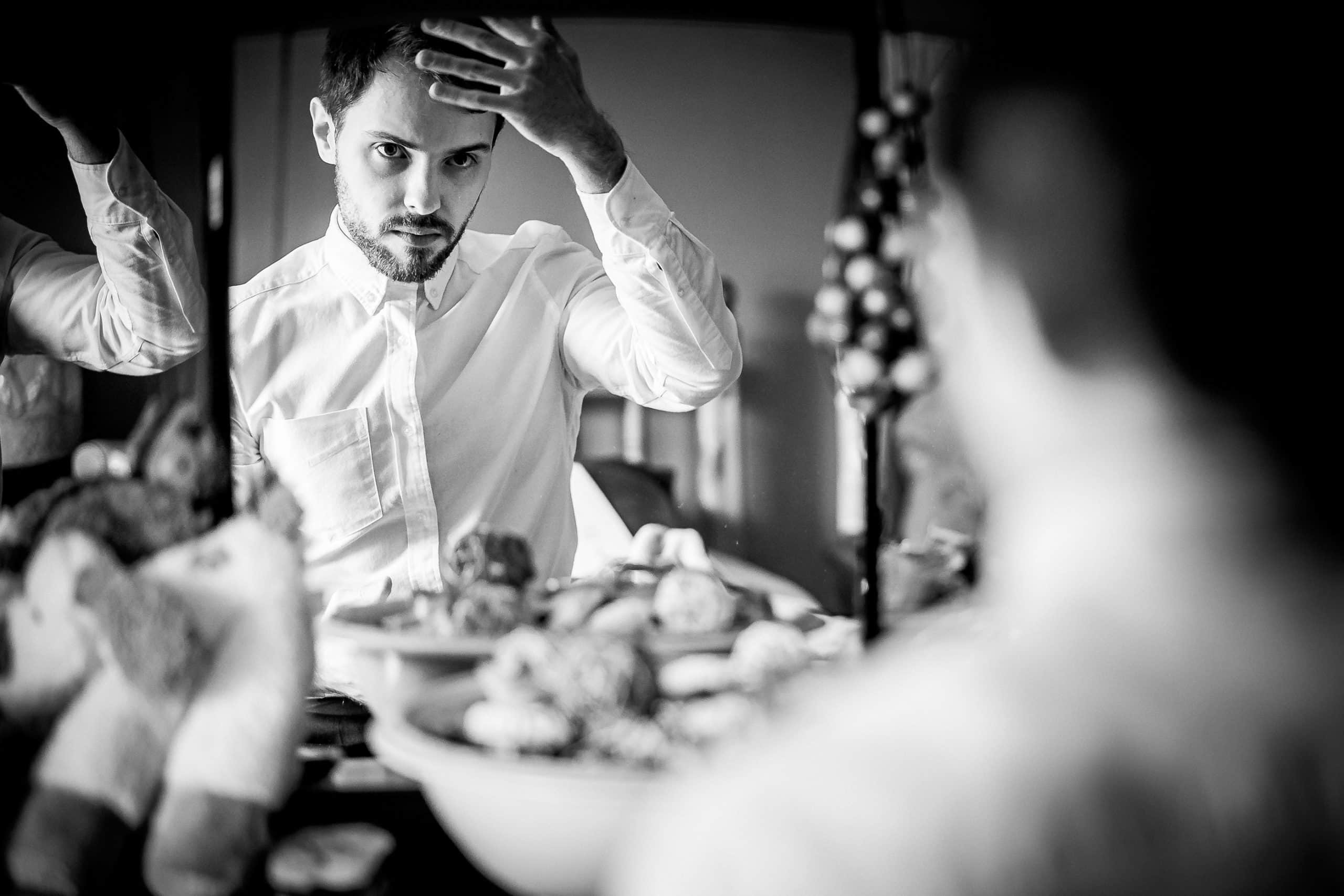 Refelection of groom in mirror