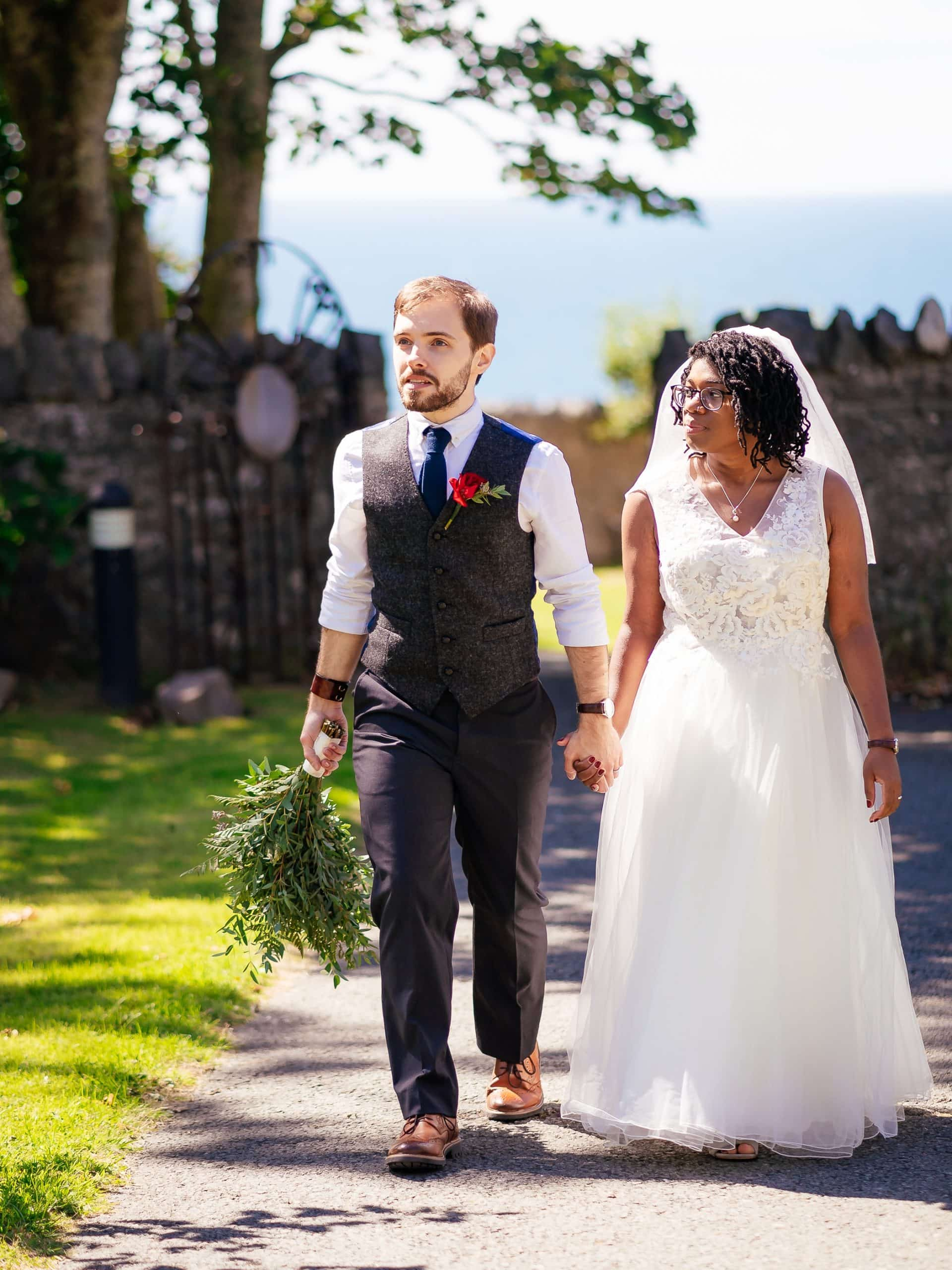 Couple walking through the grounds at Nant Gwrtheyrn