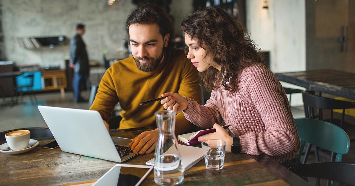 couple on laptop coffee