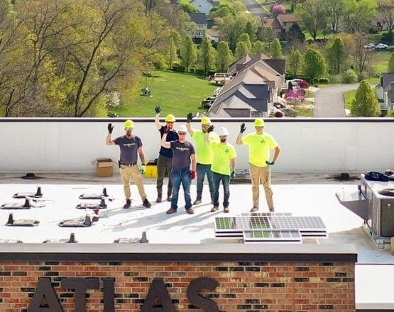 Atlast-Solar-panel-installation-crew-waving-commercial-business-west-virginia