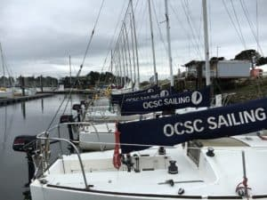 J24 main sail covers lined up at OCSC Sailing School
