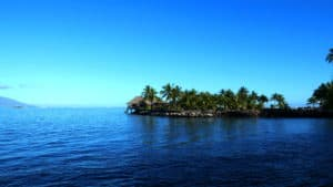 Hut at the waters edge in Tahiti