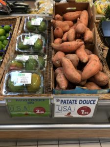 Yams and avocado for sale on display in grocery store