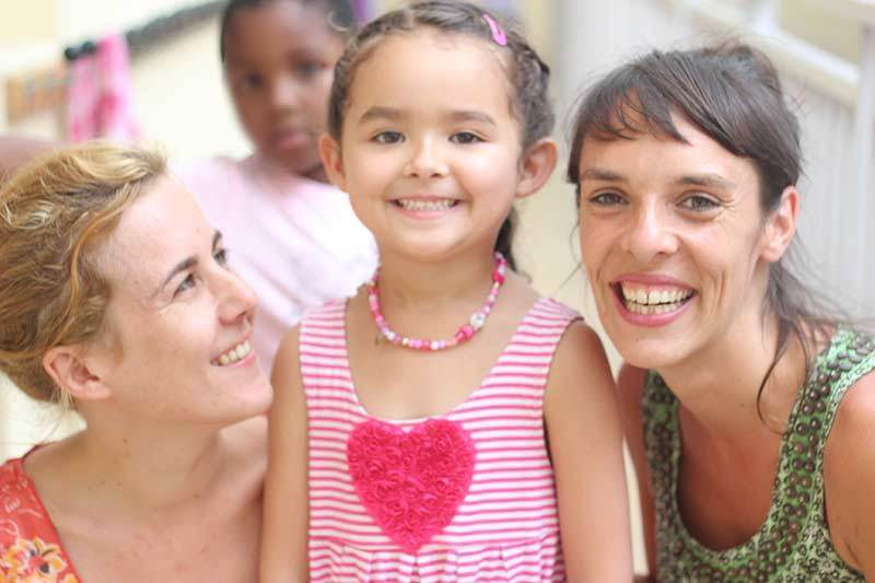 photo of Catherine with her preschool teachers in Marseille France, 2011