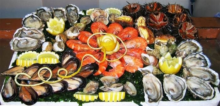Weird french new years eve foods: raw sea urchin and crustacean