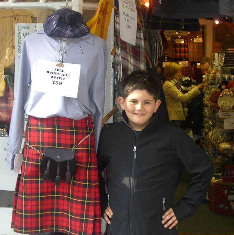 Son during our family honeymoon standing in front of a mannequin wearing a rugby kilt outfit