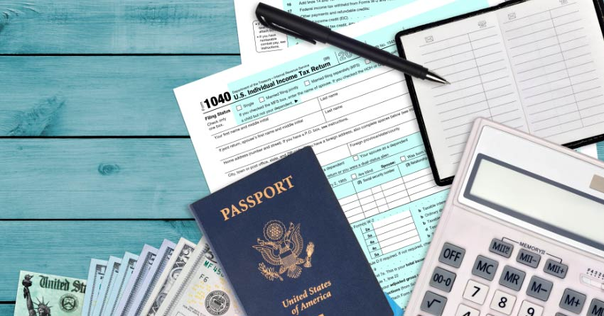 Image of passport on world map for taxes for expats reviewimage