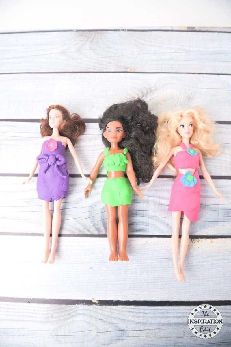 play doh creation and play doh dresses on barbie dolls and moana