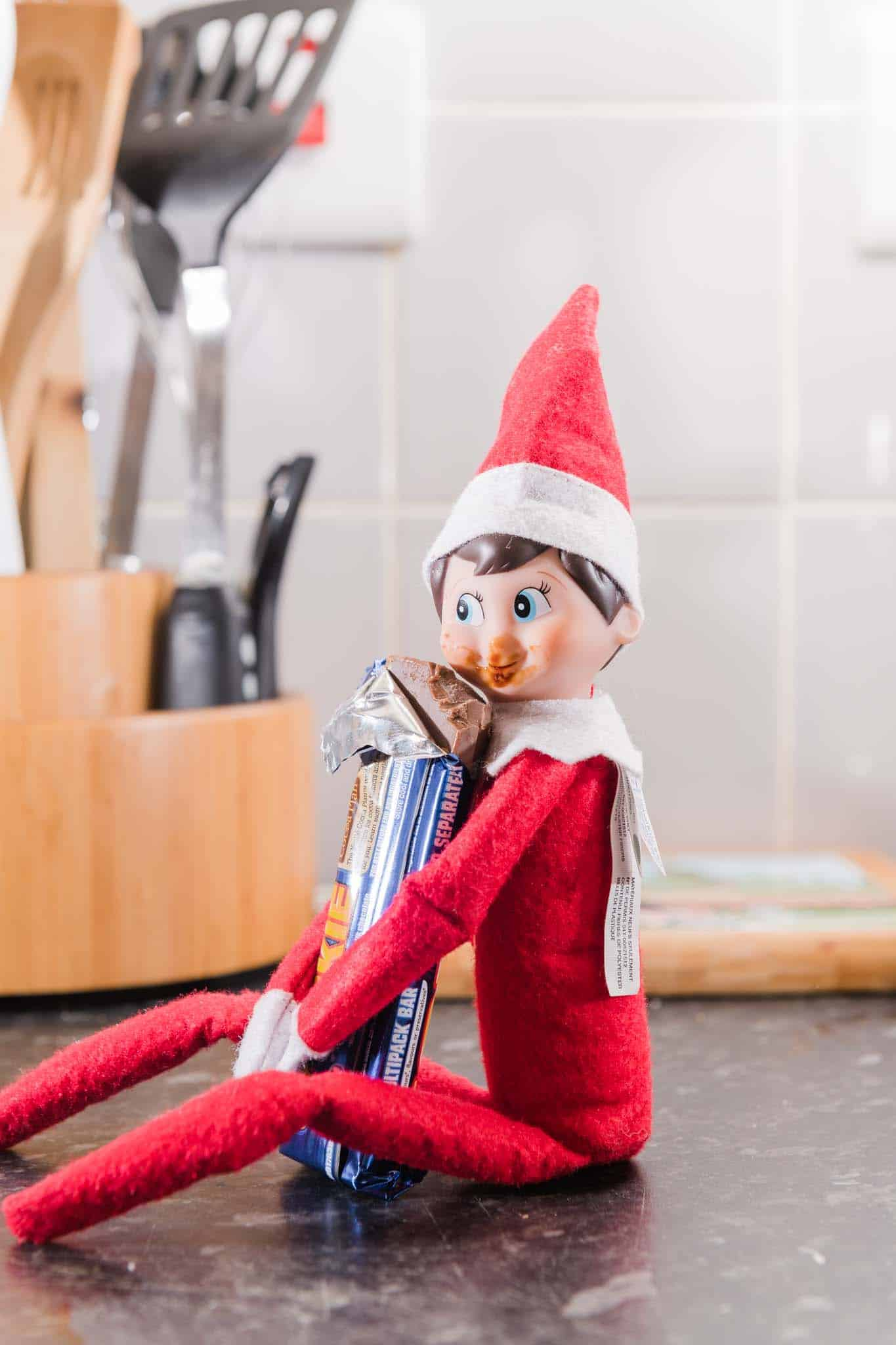 Easy Elf on The shelf Ideas the elf is eating chocolate