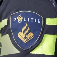 Amsterdam , Netherlands-august 20, 2015: batch on the uniform of a dutch police officer in the steets of Amsterdam