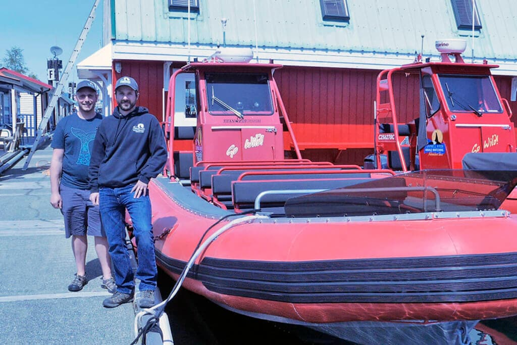Stephen Gabrysh and Tyler Bruce next to one of our Zodiac vessels