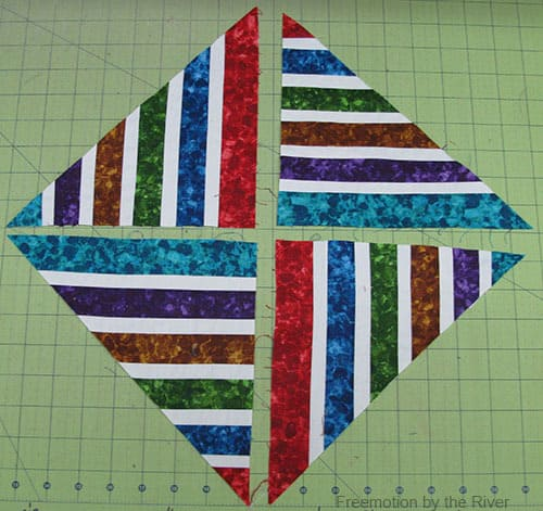 Bright Jewel Table Runner Tutorial fabrics sewed together cut diagonally and sewed