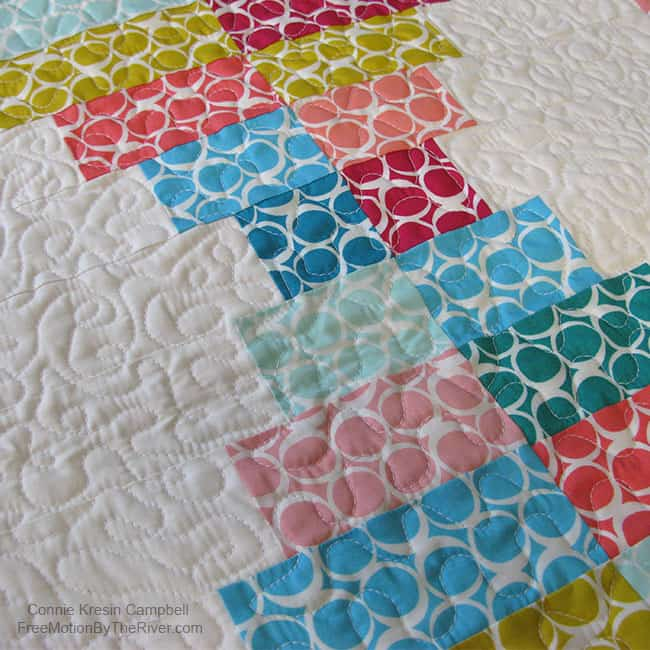 Closeup of the quilting on the Round Elements table runner