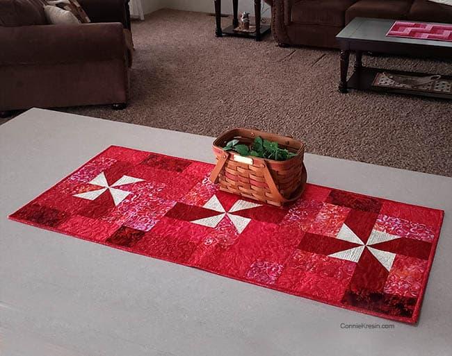 Red batik pinwheel tablerunner tutorial