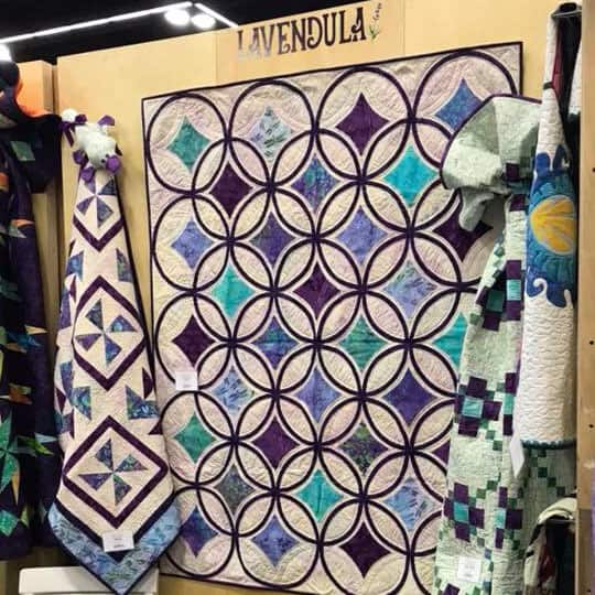 Spinners in the Island Batik booth at Market