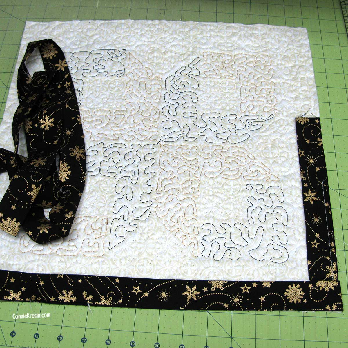 Attaching the binding to the back of the centerpiece