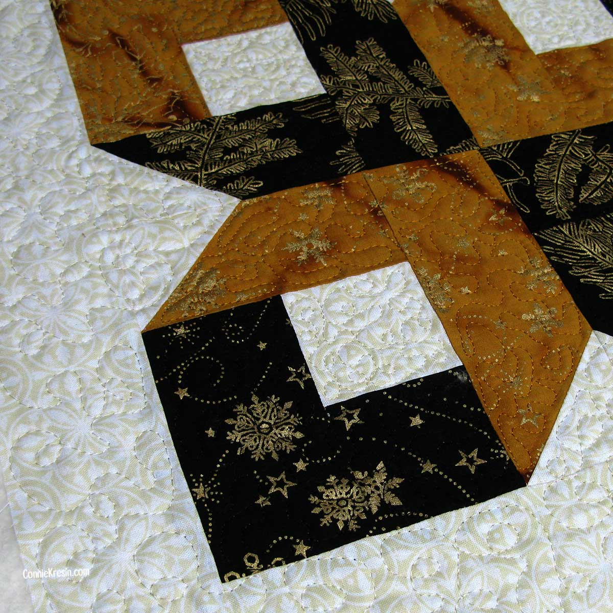 Closeup of the quilting done on the Box quilt block center piece