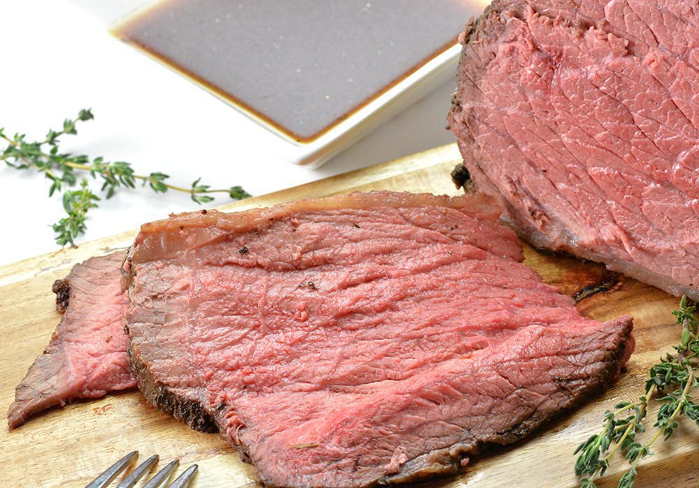Roast beef - Sliced on wood cutting board