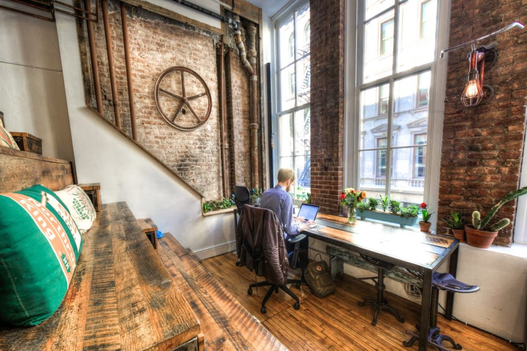 Man with his laptop in a coworking space