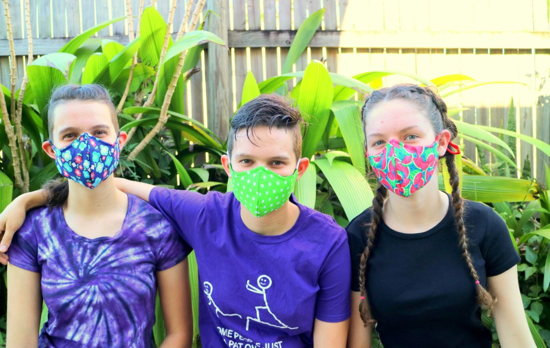 Three girls wearing handmade cloth face masks - the Three Masketeers