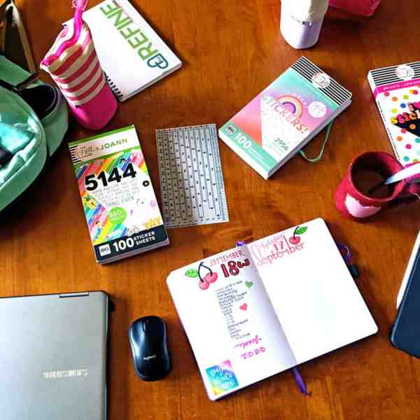 Bullet journal and stickers on a table