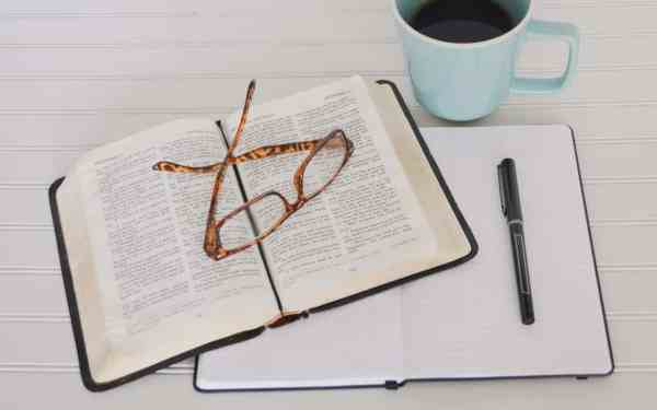 Bible and journaling on a desk