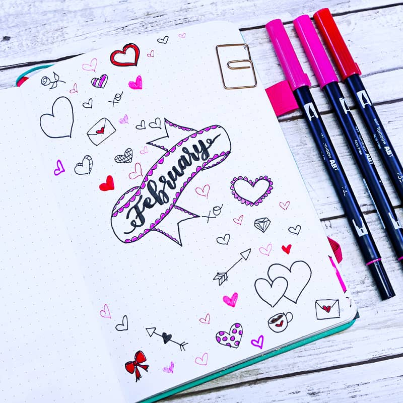 Bullet journal cover page with lots of heart doodles in many different colors and styles