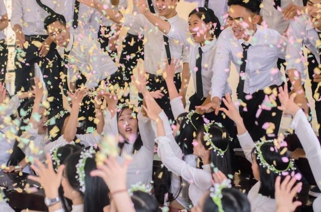Vietnamese pupils celebrate finishing high school.