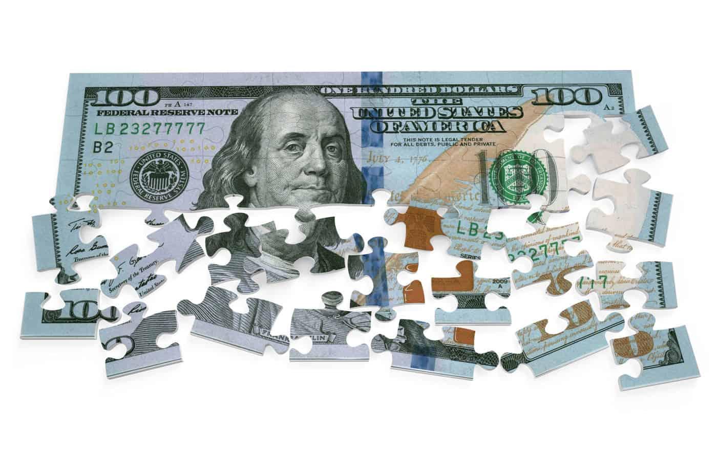 100 dollar puzzle isolated on white background