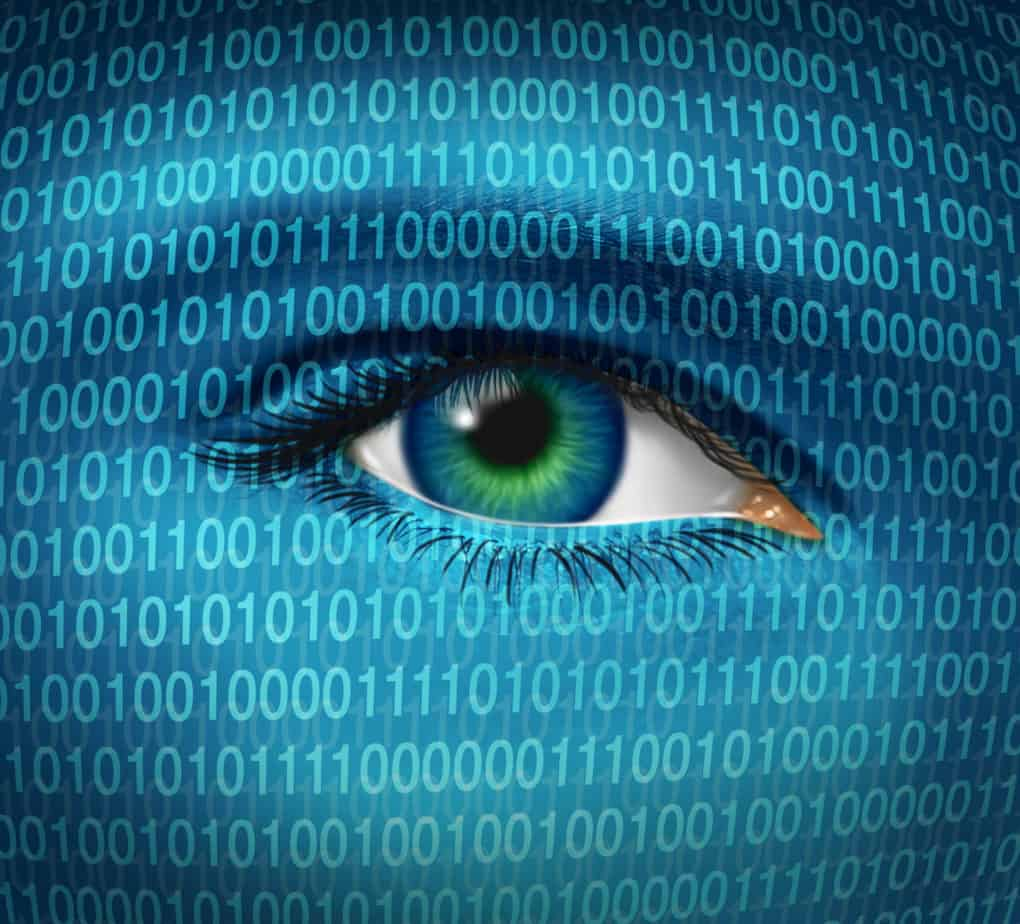 a human eye and digital binary code representing surveillance of hackers or hacking from cybercriminals