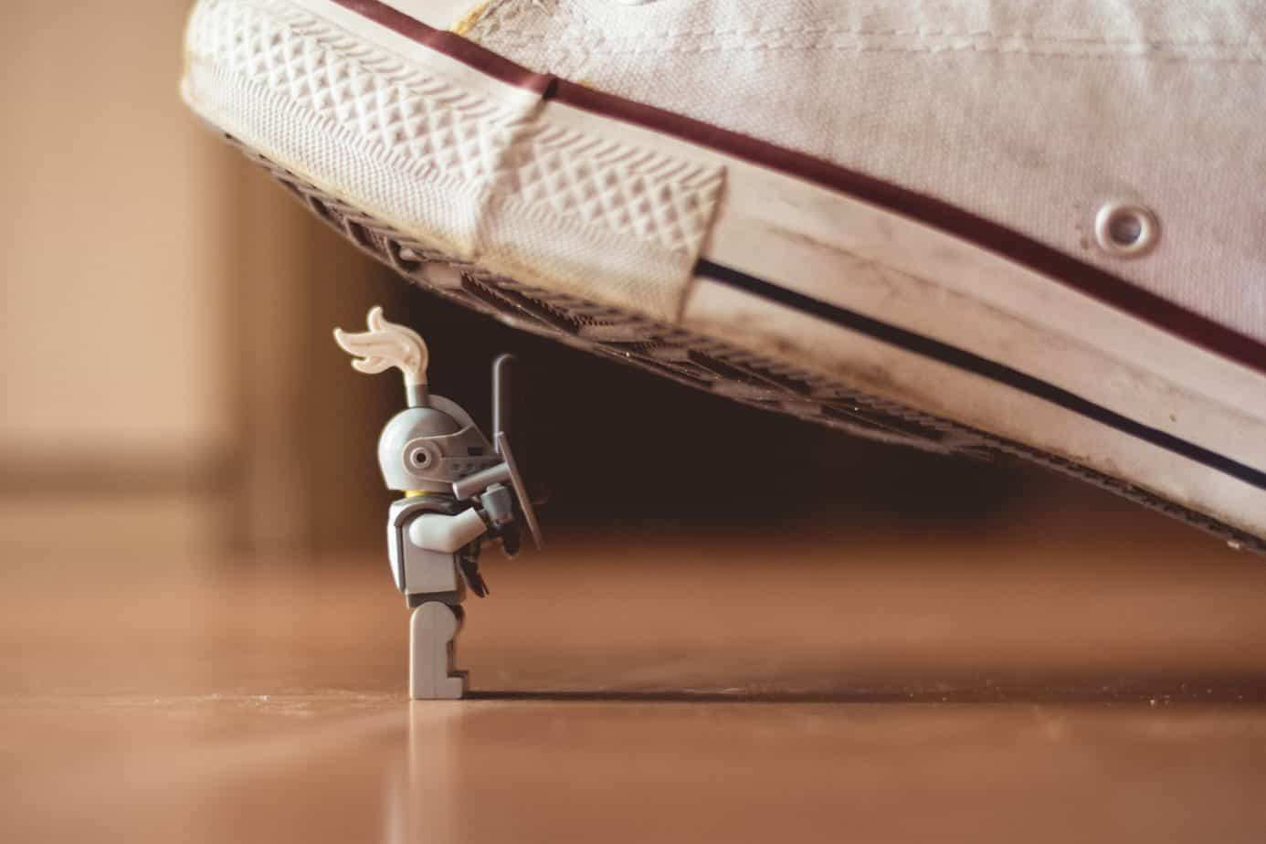 Toy soldier under the heel of a sneaker
