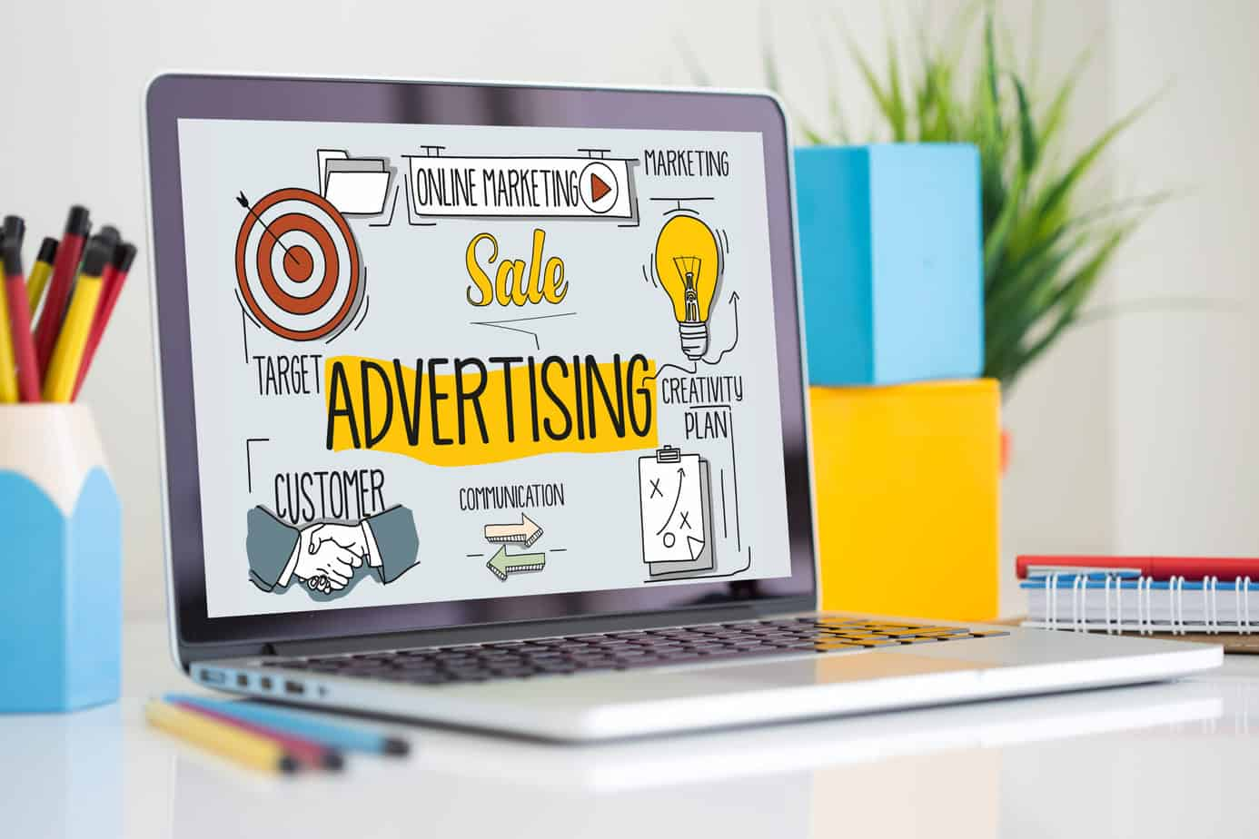 A laptop with the advertising online marketing process displayed on the screen