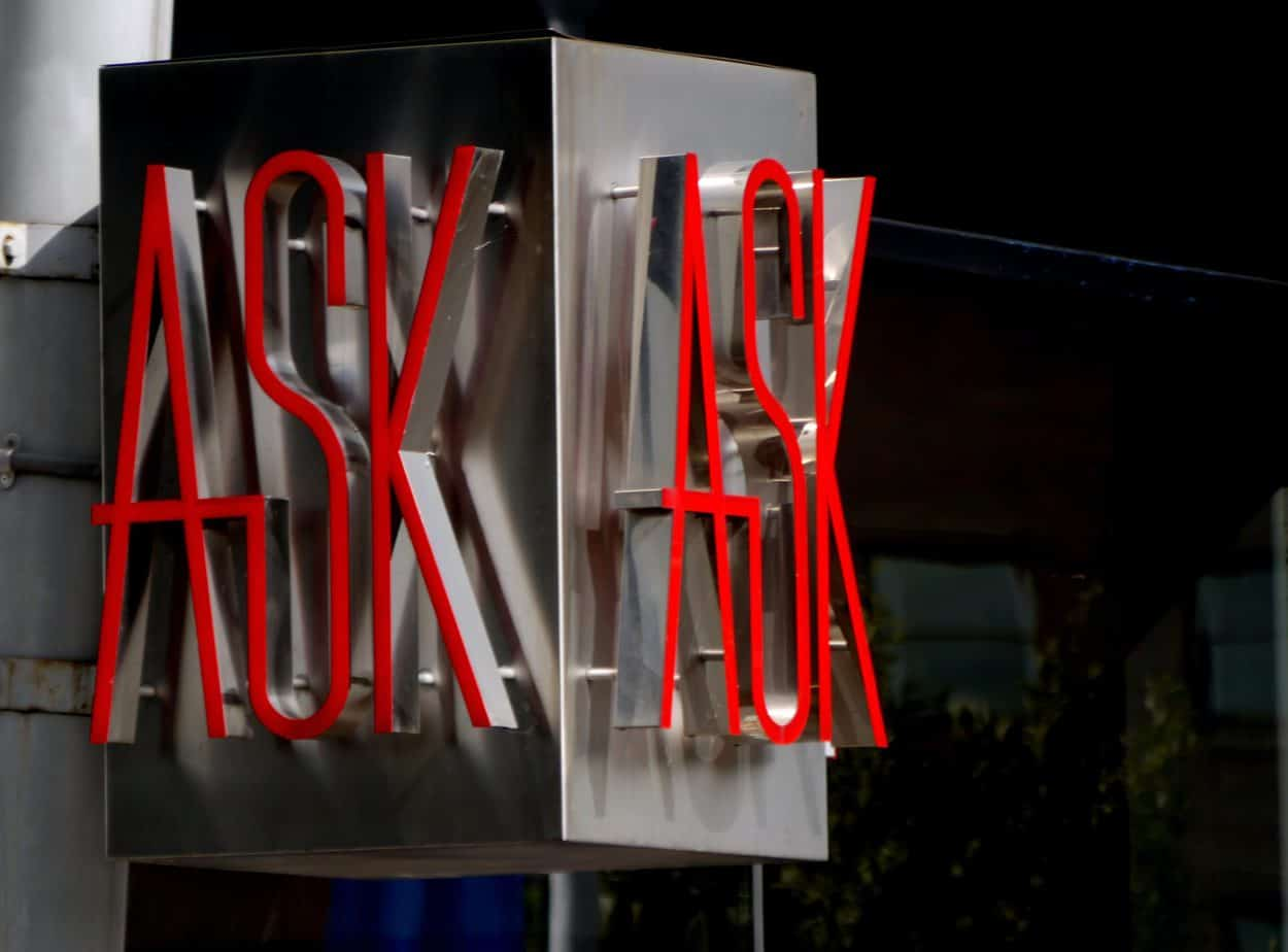 A neon sign that says ask