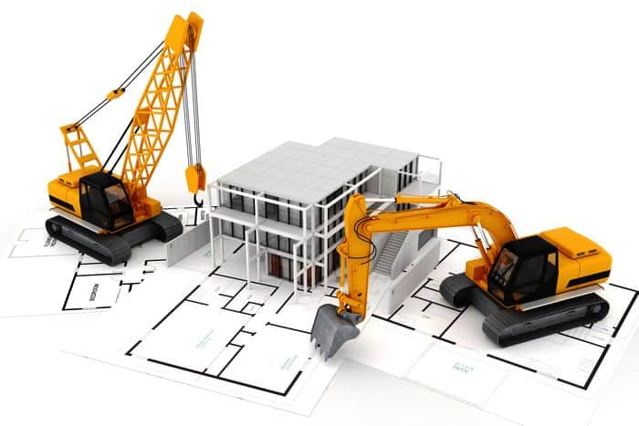 Construction Machinery next to model of house