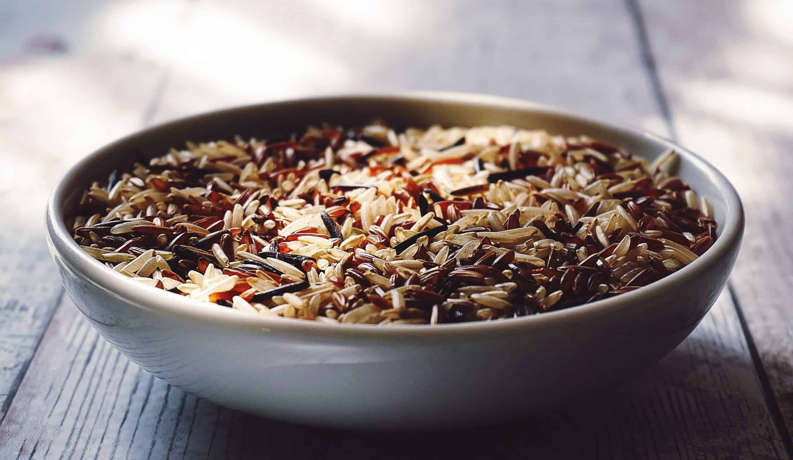 A white bowl of brown rice.