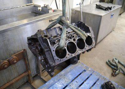 Engine block ultrasonic cleaning