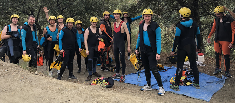 The developers don wetsuits & helmets for some canyoning fun