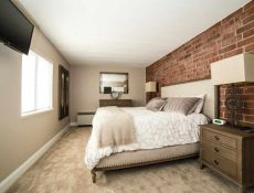 Nicely furnished bedroom of an apartment inside the Allenway