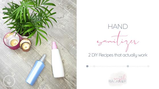 DIY hand sanitizer bottles on grey surface