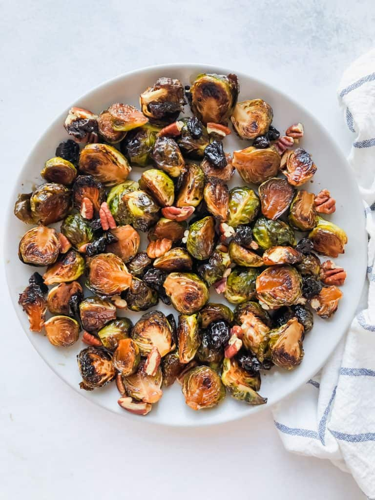 roasted maple balsamic brussels sprouts in bowl on white surface