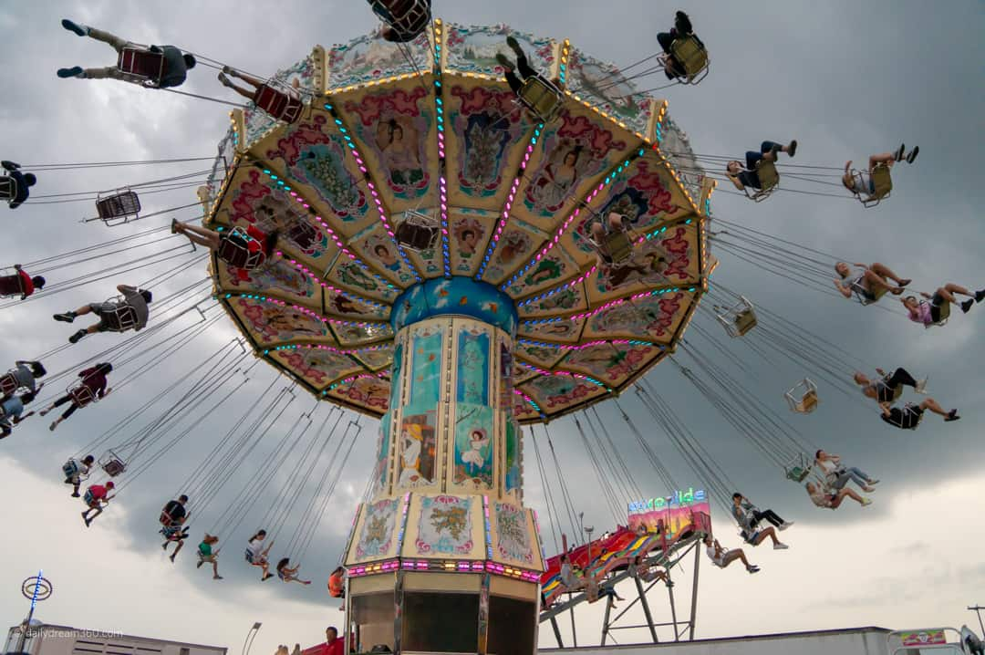 Swing ride at CNE people scattered in air.