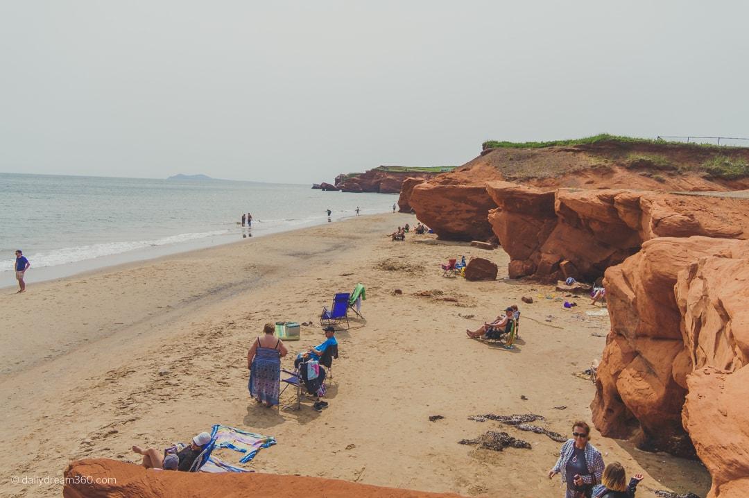 Look at beach and red rocks on Dune de Sud Beach Iles de la Madeleine Quebec